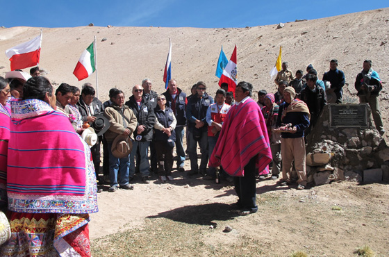 Peruvian indigenous people and Jacek Palkiewicz celebrate the unveiling of a plaque at the Apacheta brook, the starting point of the Amazon River